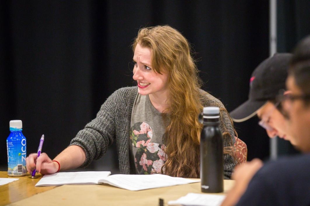 Student actors rehearse a play.