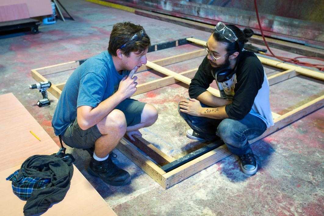 Crewmembers consult on set building.
