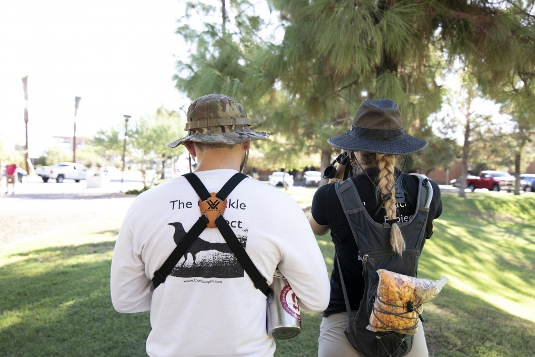 Melissa Folsom and Michael Pickett conduct field work observing grackle behavior on ASU's Tempe campus.
