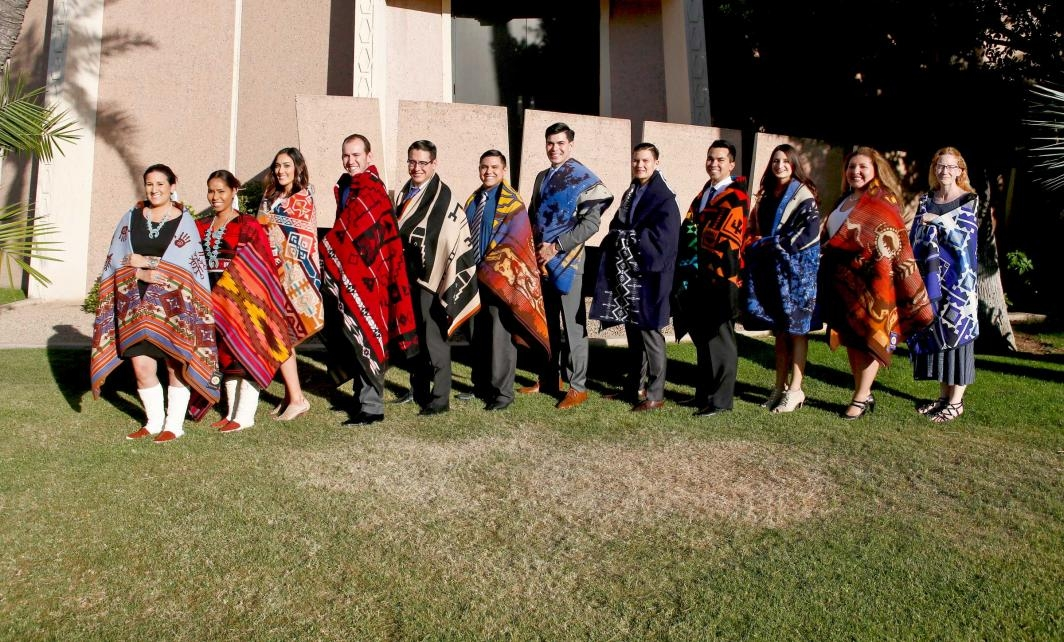 graduates posing after Indian blanket ceremony