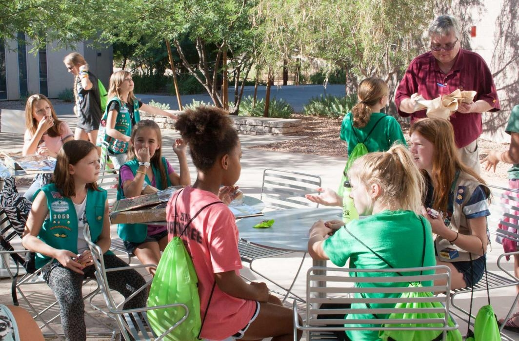 Girl Scouts eat s'mores made in solar ovens they built earlier in the day at ASU Polytechnic campus