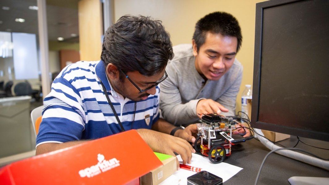 Students work on a robot.