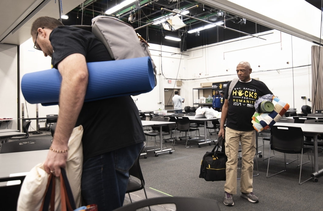 Arcelious Stephens and other participants pack up after the Hacks for Humanity 2019.