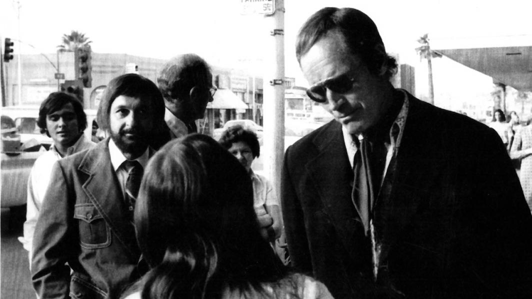 Charlton Heston and Salerno talk to students