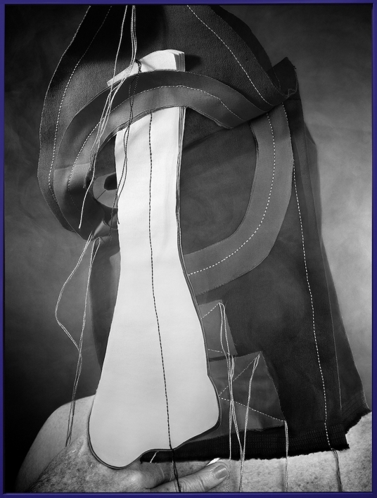 art photograph of white cloth intersecting with black cloth