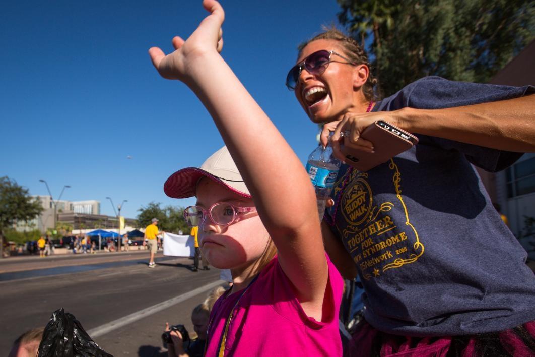 People cheer during the ASU Homecoming Parade