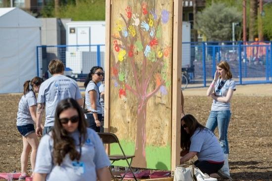 students create a mural at CGI U