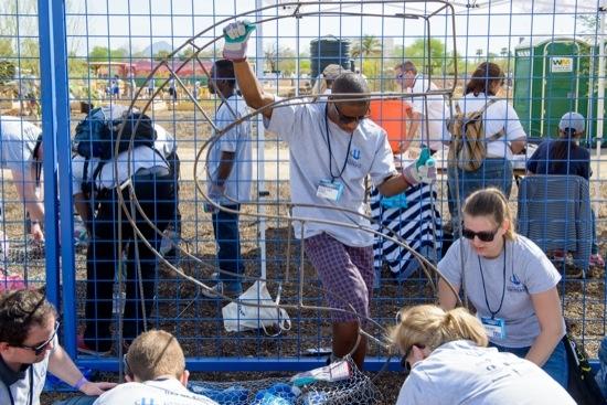 participants volunteering at CGI U