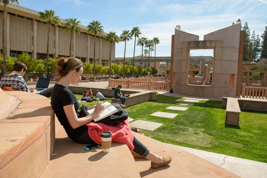 ASU student reading on Hayden Lawn