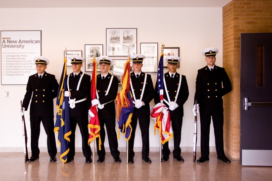 midshipmen standing with flags