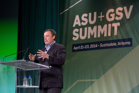 ASU President Michael Crow speaking at a podium during ASU+GSV Summit