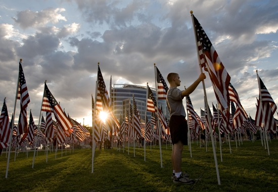 man placing American flag