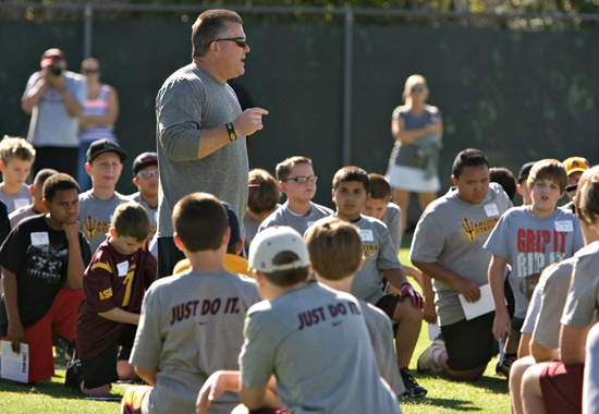 coach talking to summer campers