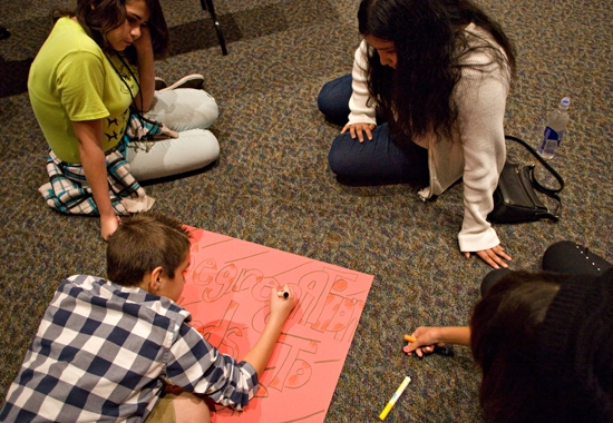 students working on posters