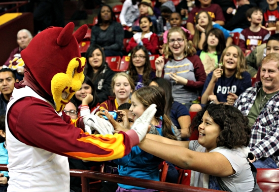 Sparky greeting young students