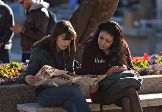 two female students sitting on bench