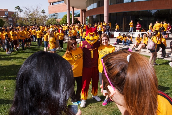 students pose with Sparky