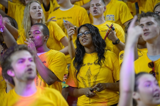 crowd of ASU students singing fight song