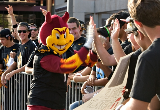 sparky greeting students