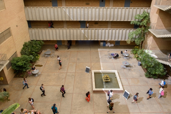 students walking across courtyard of the ASU Farmer Education Building