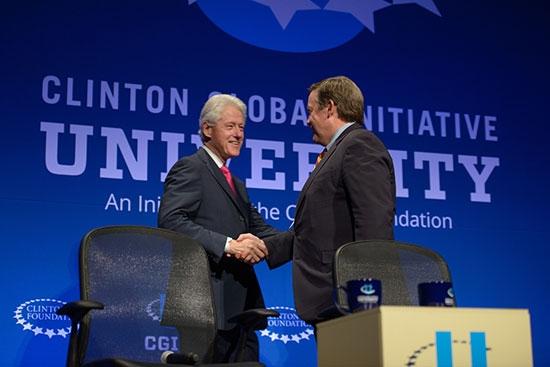 Bill Clinton and ASU President Michael Crow shaking hands at CGI U at ASU