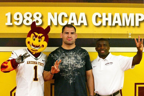 two men displaying pitchfork hand sign with sparky mascot