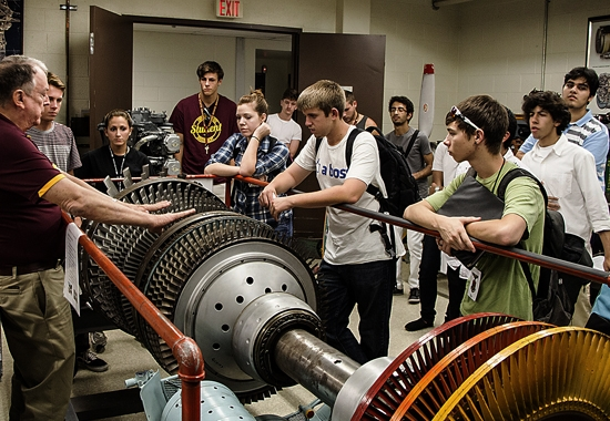 students looking at machine