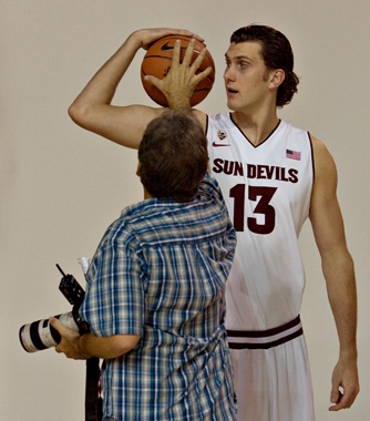 photographer posing basketball player