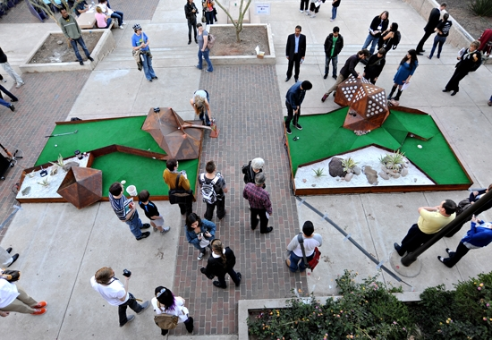 people interacting with golf exhibit