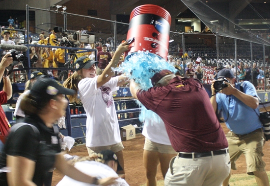 coach being showered with sports drink