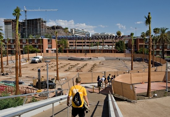 students walking by area under construction