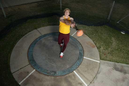 man doing weight throw