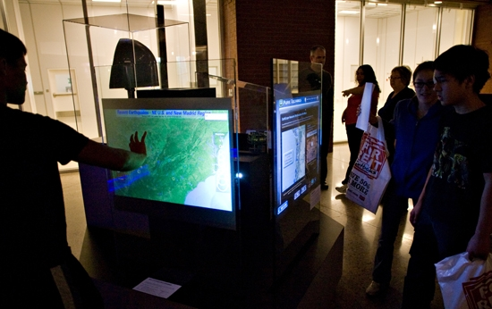 visitors interact with displays
