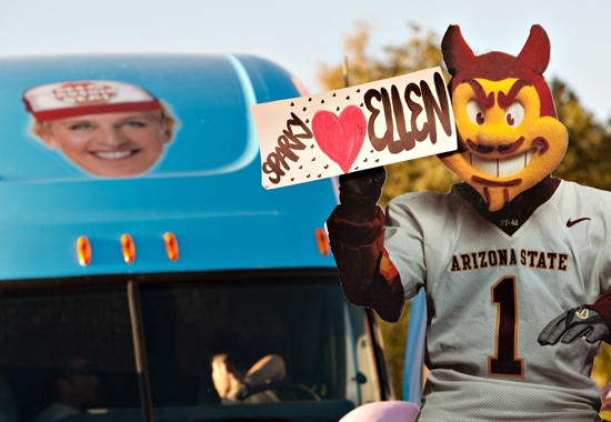 sparky holding sign