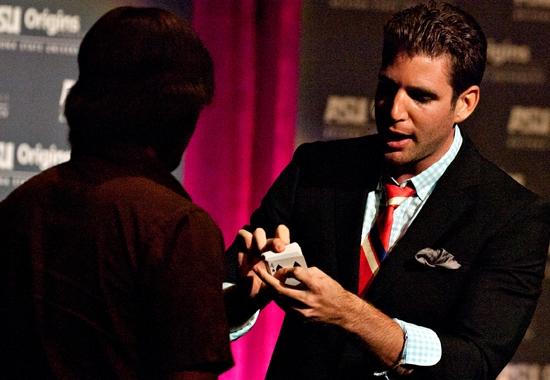 man performing magic trick