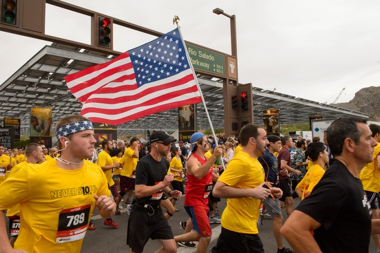 runner carrying the American flag