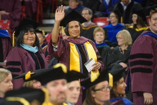 woman placing hood on doctoral graduate during ASU graduate commencement