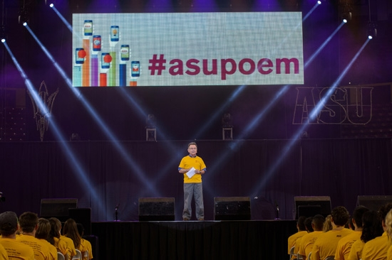 ASU professor on stage during Sun Devil Welcome with #asupoem on screen behind