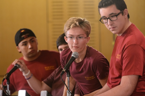 student on Public Programs team answering a question