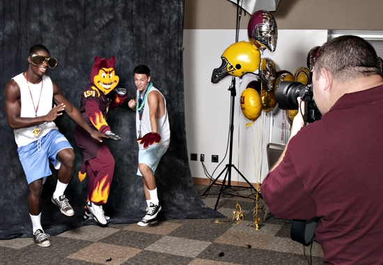 man taking picture of students with Sparky