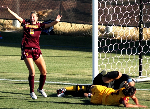 women's soccer player celebrates