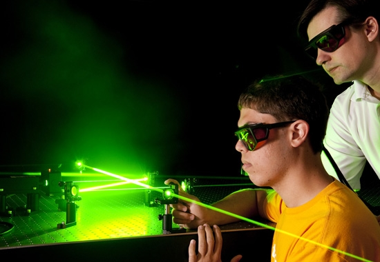 student working with laser beam