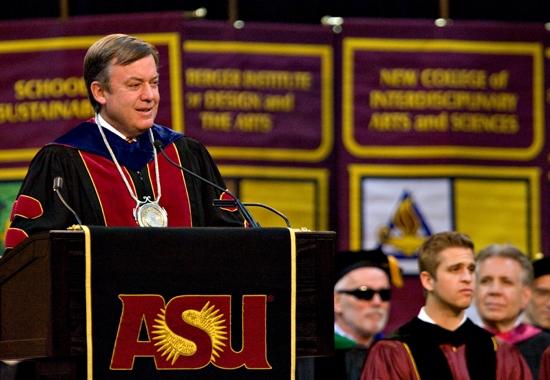 man speaking to graduates
