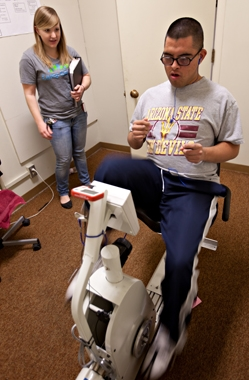 Down syndrome patient using a cycling machine