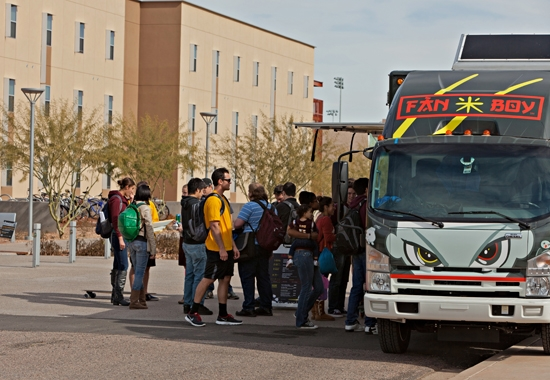 students lining up at food truck