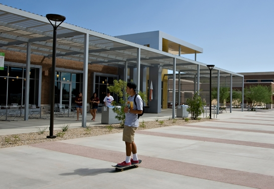 student skateboarding in front of building