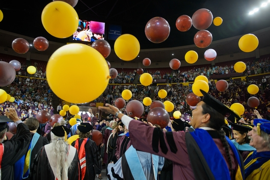 balloons dropping in Wells Fargo Arena during graduate commencement
