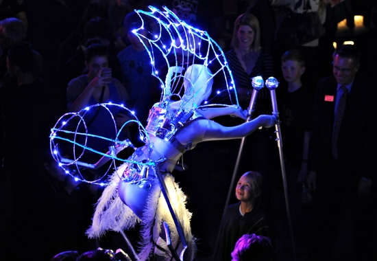 woman dressed in light up spider costume