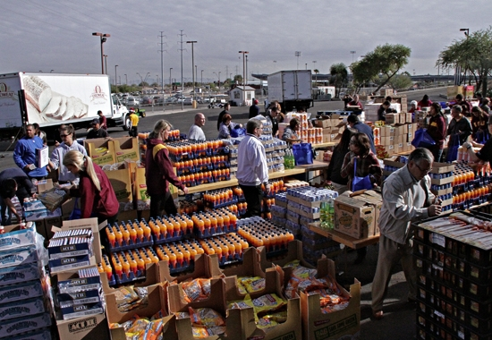 people packing food baskets