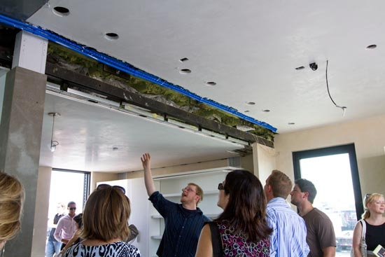 people looking at radiant cooling system inside SHADE project